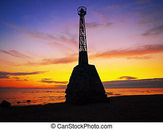 beacon on the seashore against the dusk