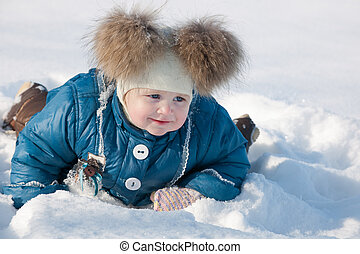 Dashing through the snow - A cheerful little girl in blue is...
