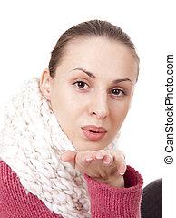 Beautiful woman in winter scarf blow kisses - Beautiful...