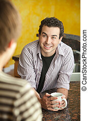 Two Friends Talk - Young handsome man with friend enjoys mug...