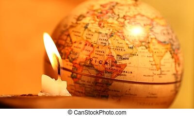 Old globe with Candle light