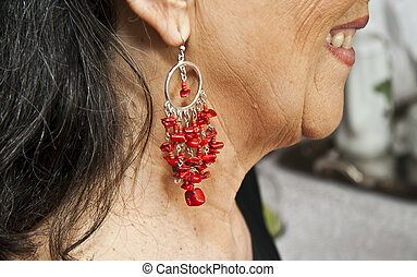woman with ear rings - middle age woman profile , close up...