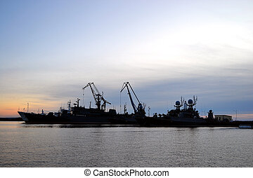 Navy base in Kronstadt at sunset background - Russian power...