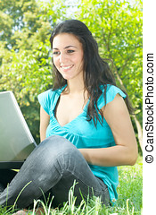 happy young woman using laptop outdoors - Beautiful happy...