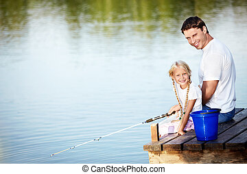 Fishing - Father and daughter fishing on the lake