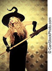 broom - Charming halloween witch with broom over vintage...