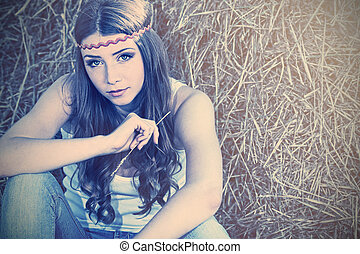 countryside - Romantic young woman posing outdoor.