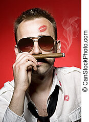 man smoking cigar - young handsome man with cigar and lips...