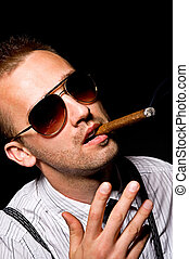 man smoking cigar - young handsome man smoking cigar