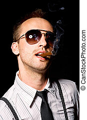 man smoking cigar - young businessman smoking cigar