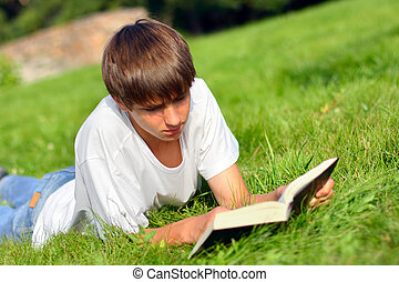 teenager read book - The teenager reads the book on a summer...
