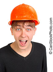teenager in hard hat - amazed teenager in old and damaged...