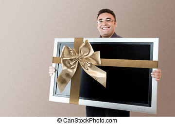 Man holding lcd tv - Man holding in hands lcd tv with flat...