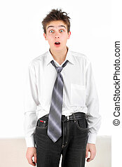 shocked teenager isolated on the white