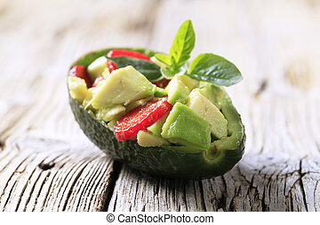 Avocado salad served in an avocado peel