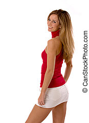 Blond beauty in mini skirt isolated on white - Three quarter...