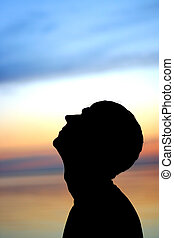 man silhouette on the sunset background