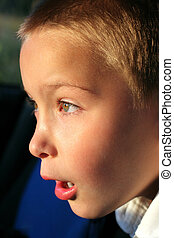 amazed boy portrait close up