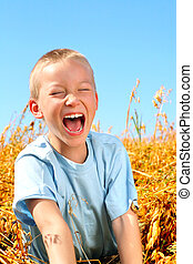 happy boy - happy young boy in the wheat field