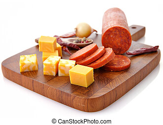 Pepperoni Salami and cheese on a cutting board