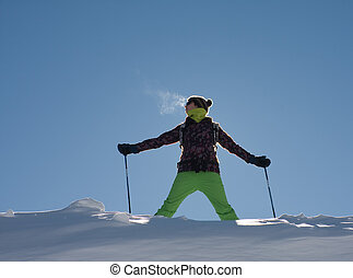 A girl in a ski suit against the sky