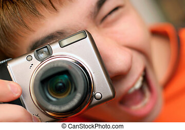 take a picture - A young teenager gets ready to take a...