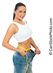 Happy slim woman measuring waist - Happy slim woman in large...
