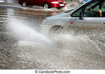 car in floods - Flooding in the city with car and driving...