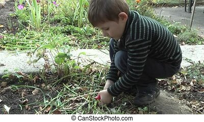 Gardening, - children work in the garden