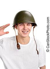 teenager in helmet - The teenager in a military helmet