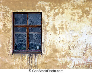 window and old wall - part of the house with the window and...