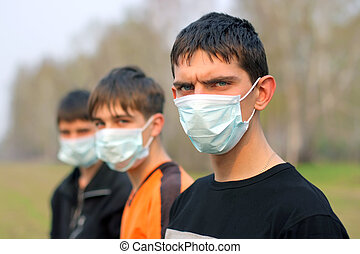 teenagers in mask - three teenagers in the mask outdoor