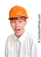 teenager in hard hat - amazed teenager in a hard hat