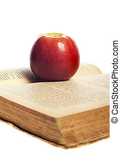 apple book - red apple on a book on white