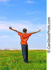 teenager in the field - happy teenager stand on the summer...