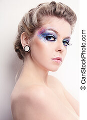 Makeup - Beautiful young woman with stylish hairdo and fancy...