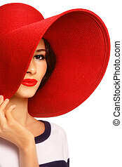Woman in red hat - Portrait of young beautiful woman in red...