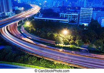 A road junction with blurred colorful lines at dawn