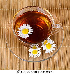 Glass cup with a camomile tea - Glass cup with fragrant a...