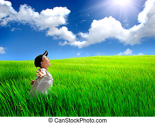 happy kid in the field - The happy child on a summer field