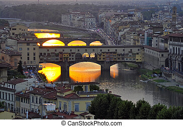 Ponte Vecchio in Florence, Italy at sunset
