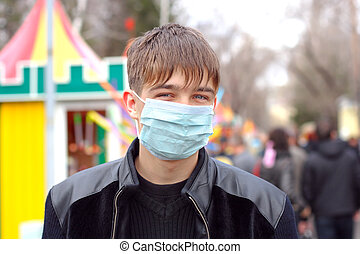 teenager in mask - teenager in the flu mask on the street