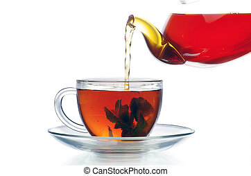 tea cup - Tea being poured into glass tea cup