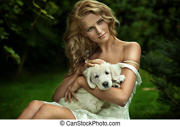 Cute young lady and a puppy dog