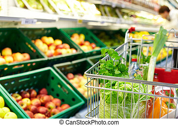 Cart with products - Image of fresh vegetables in cart in...
