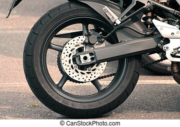 motorcycle - A rear view of a motorcycle, wheel and brake