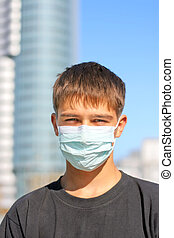 teenager in the mask - teenager in the flu mask on the...