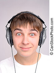 teenager in headphones - amazed teenager in the headphones