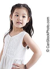 Little Asian girl in white dress on white background