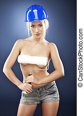 Sexy topless model holding a roller brush. - Beautiful...